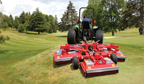 Rear mounted mower red about trimax mowing systems