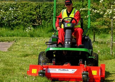 Front mounted flail mower that can be fitted to a wide range of tractors